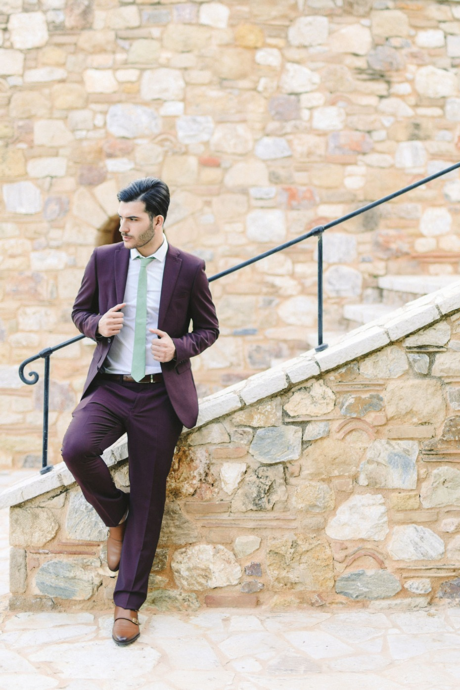 Eggplant colored suit with green tie