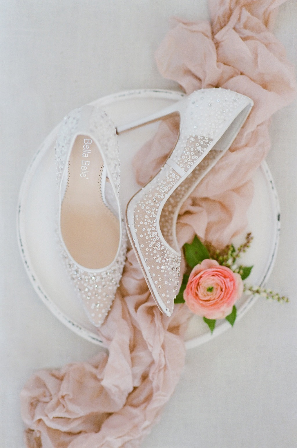 Elsa Ivory is the definition of a Cinderella-inspired sequined wedding heel that is more comfortable than a glass slipper!