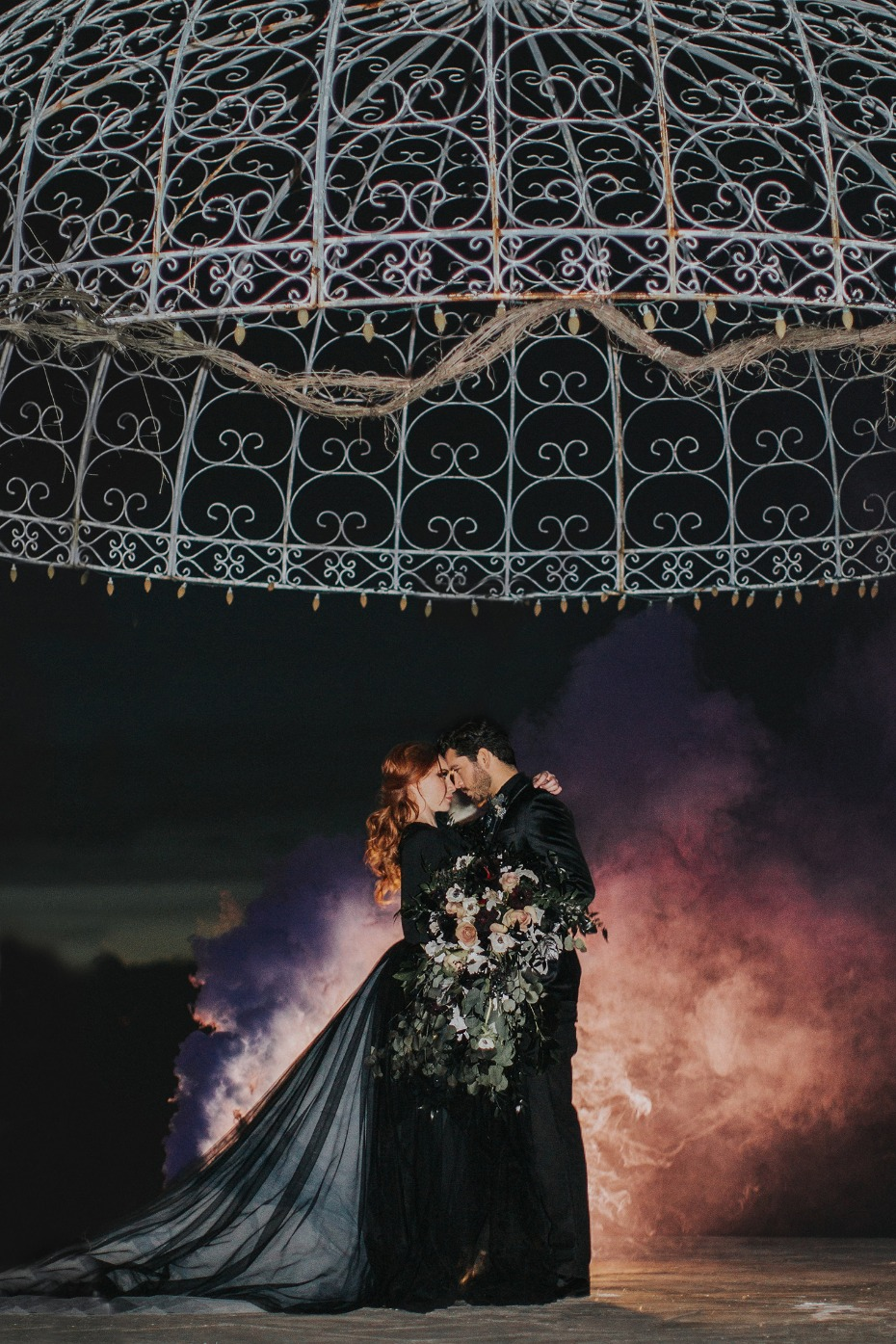 dramatic wedding portrait with smoke bomb