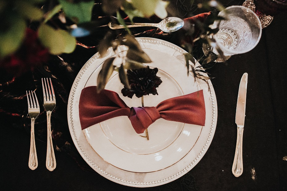 romantic and dark themed table setting