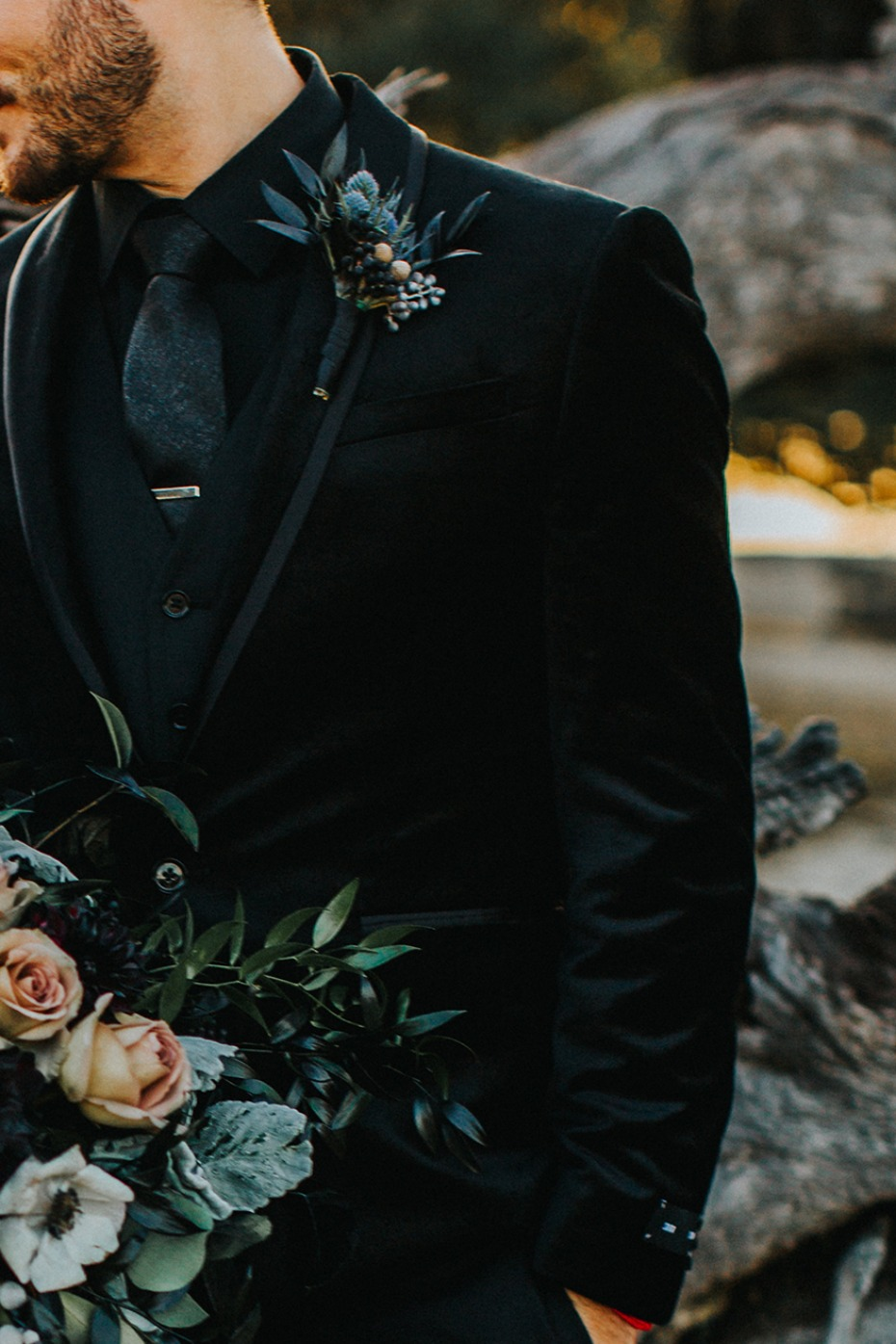 groom in black and velvet