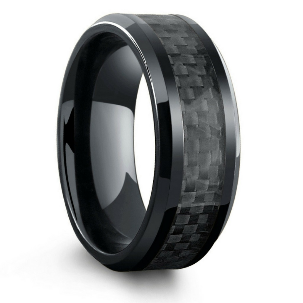 Mens black titanium wedding ring with a woven black carbon fiber inlay. This men's wedding ring is extremely lightweight and extremely