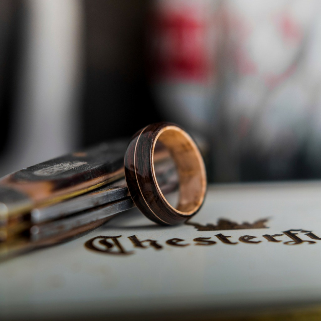 Men's bentwood wedding ring. Handcrafted out of organic materials. This bentwood ring features a Gibson guitar string inlaid through