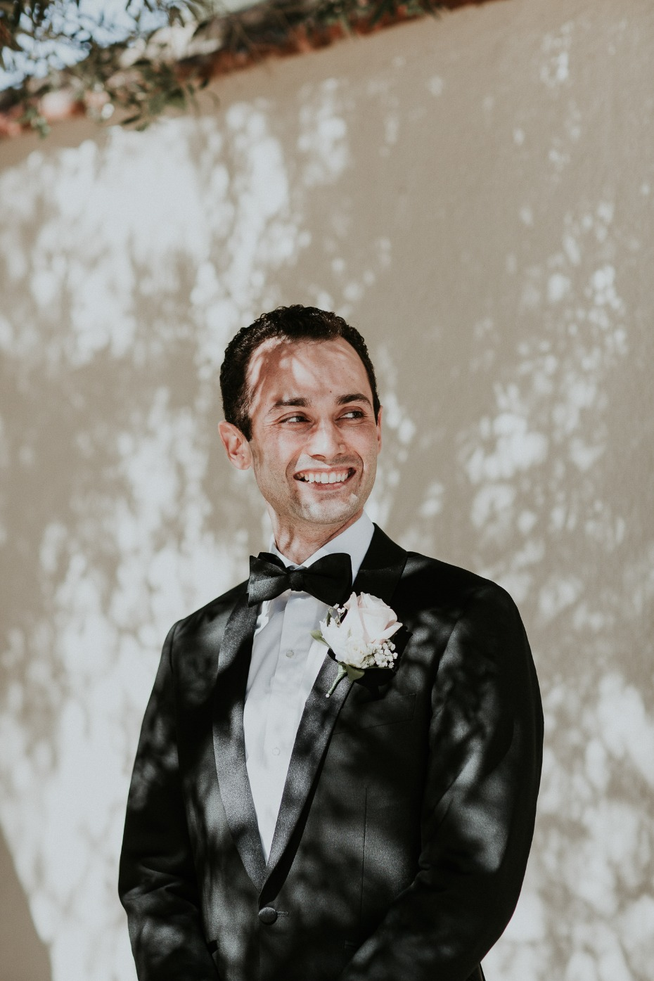 groom in black tie