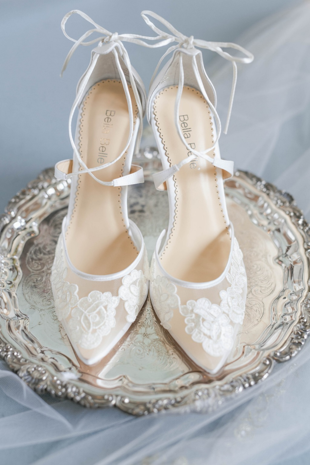 We're showing some love to Anita, a classic ivory lace wedding heel that radiates class and elegance. See more at @bellabelleshoes