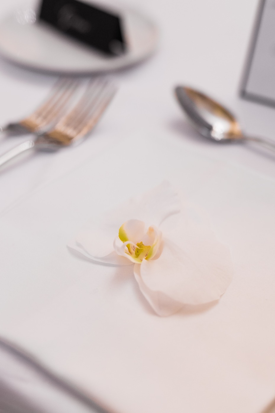 Orchid place setting for a wedding