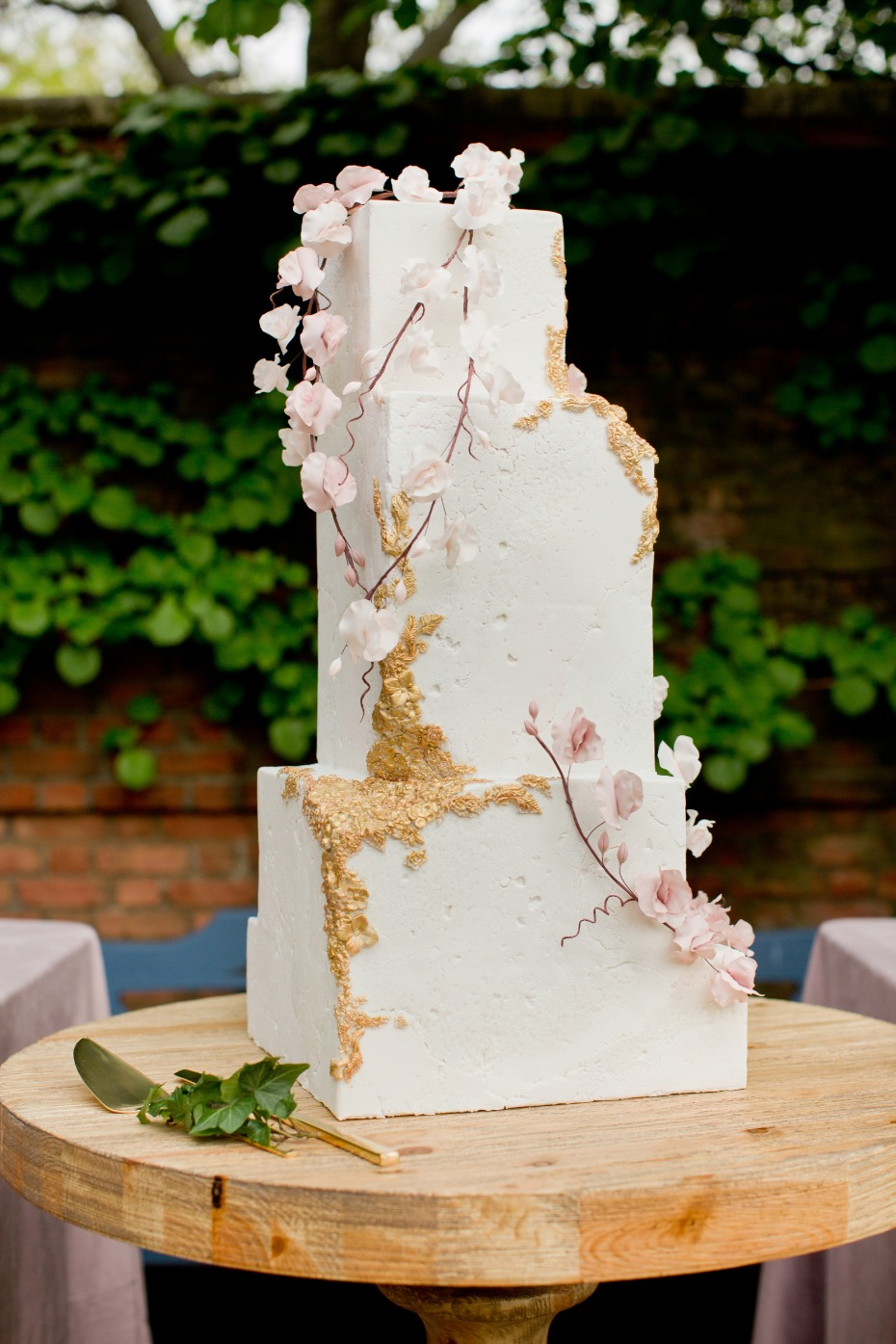 Asymmetrical wedding cake with aged rough stone fondant