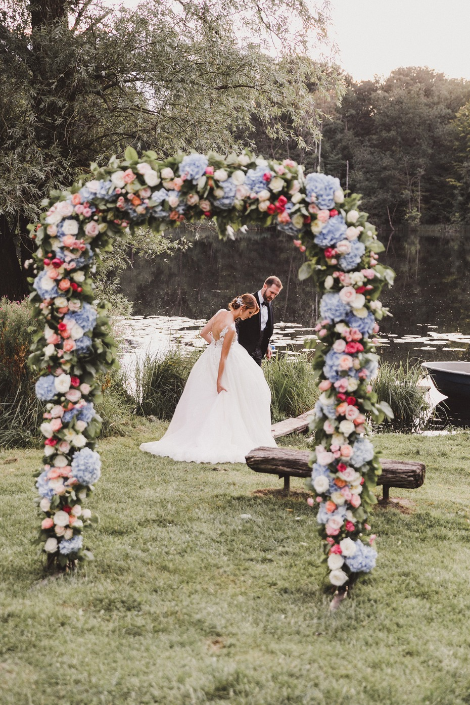 blue and pink floral wedding arch