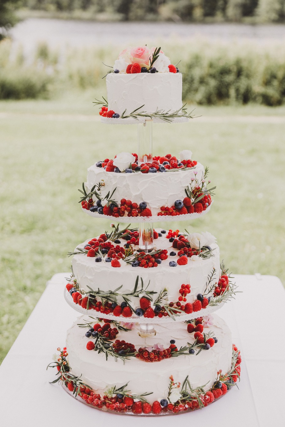 elegant berry topped wedding cake