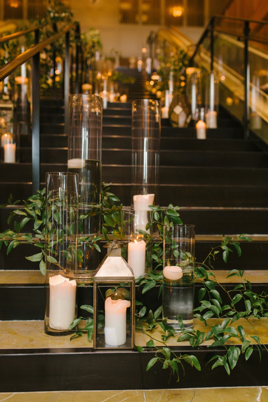 elegant floating and lantern candles stairs decor