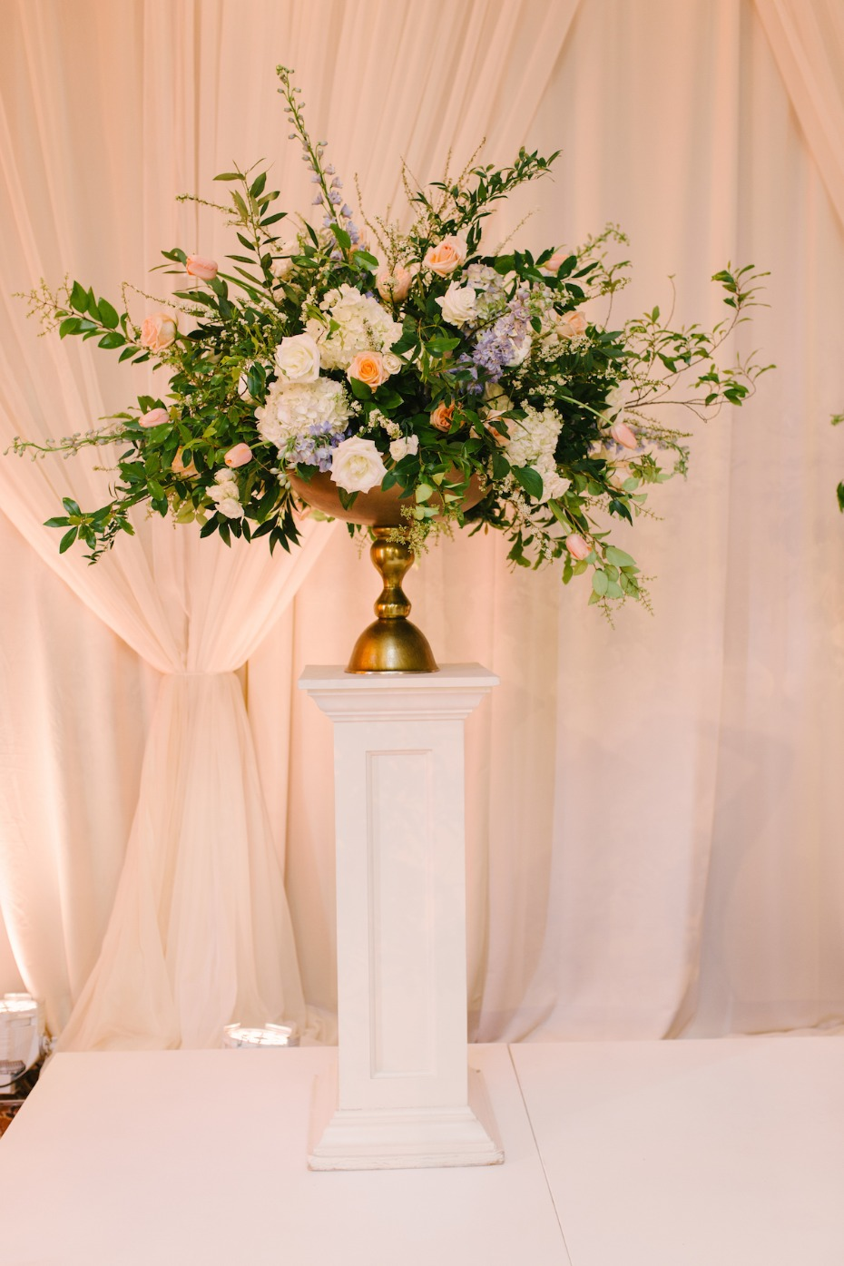 elegant wedding ceremony backdrop florals