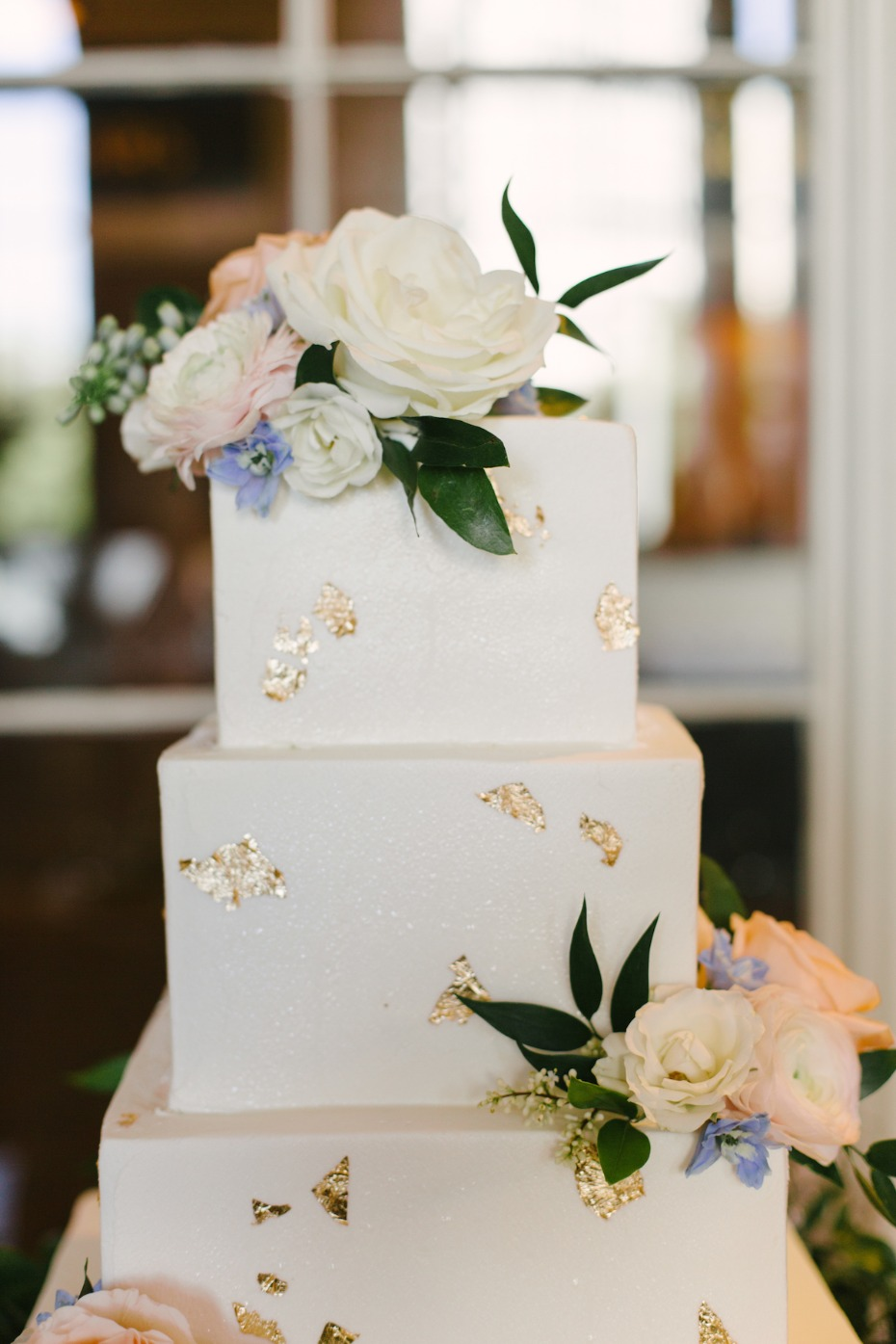 gold flaked square wedding cake