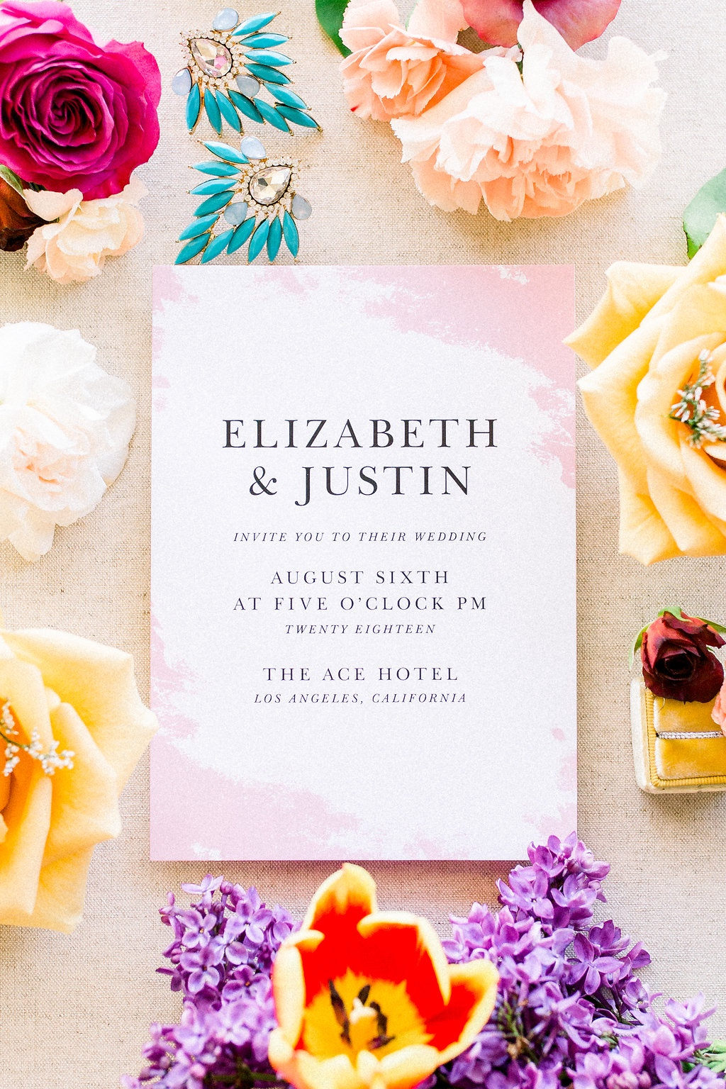 Pretty in pink! Loving this brightly styled wedding invitation for a summery look!