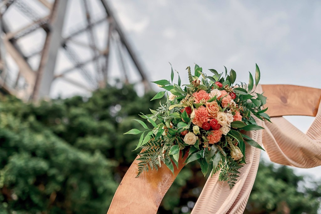Peachy arbour décor by https://www.brisbaneweddingdecorators.com.au/
