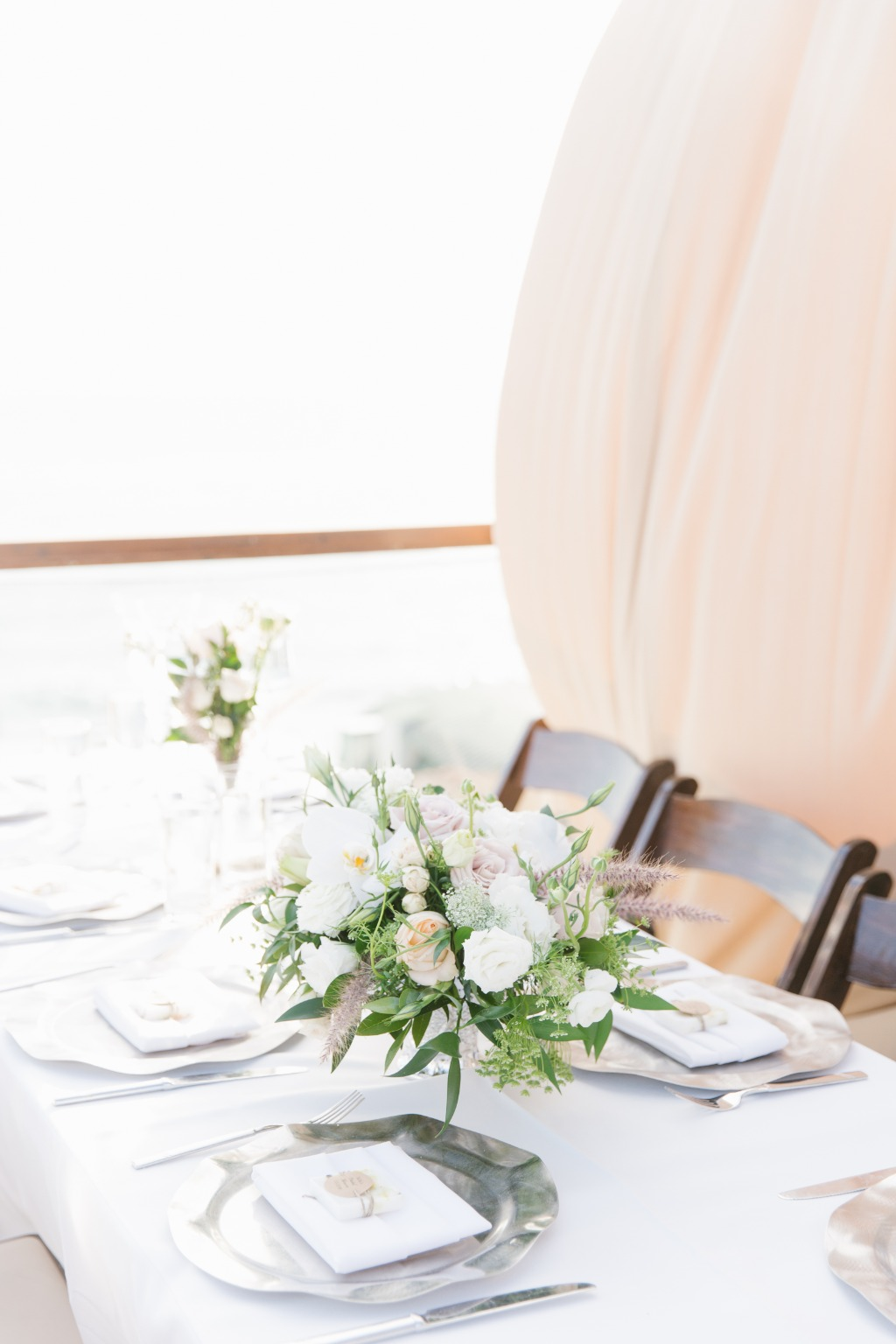 Lovely flowers and ocean breezes made for a GORGEOUS laguna beach bridal shower! See more from this day on the blog