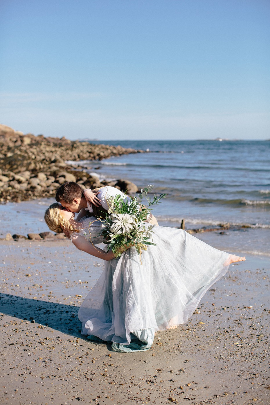 wedding dip kiss on the beach