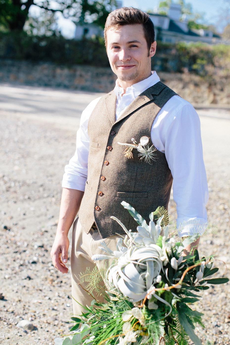 groom in tweed vest and white button down