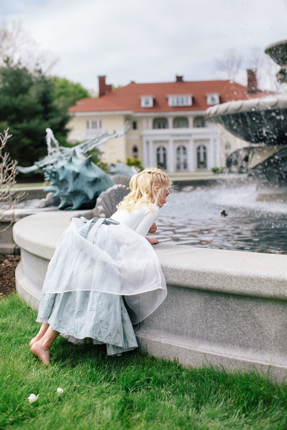 flower girl and a fountain
