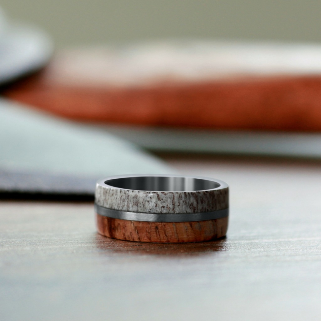 This mens wedding ring is crafted out of wood, titanium and deer antler. This ring is 100% handcrafted and made in the USA.