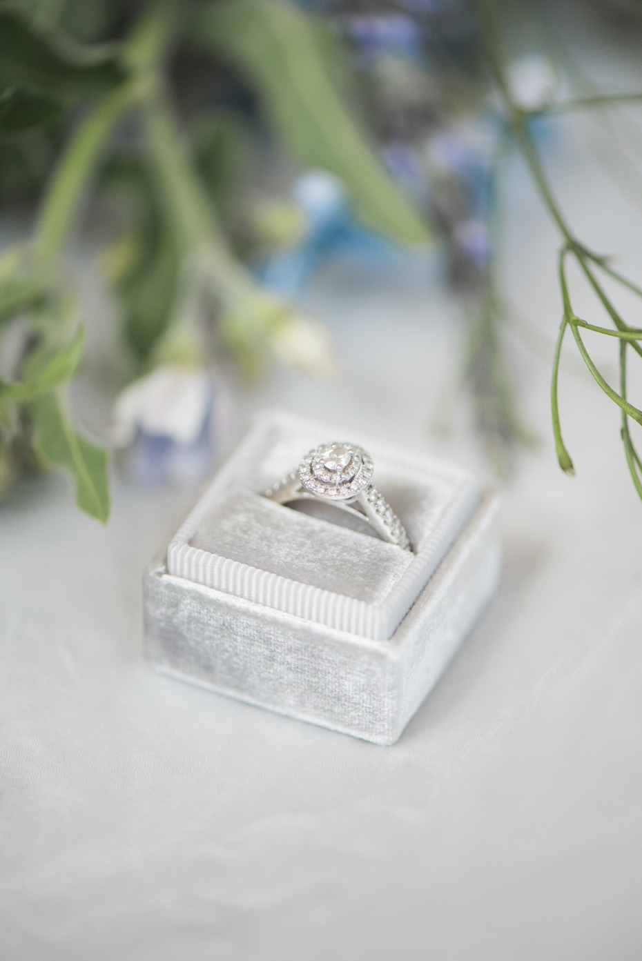 silver ring box with engagement ring