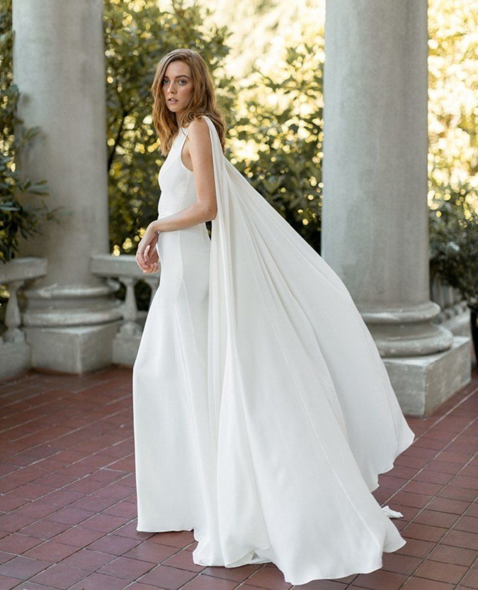 Get the look Kaley Cuoco caped wedding dress from Davie & Chiyo