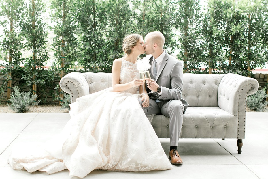 wedding kiss in a Hayley Paige dress