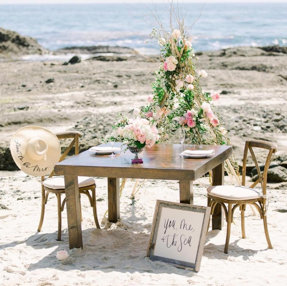Set up for beach proposal - you, me and the sea