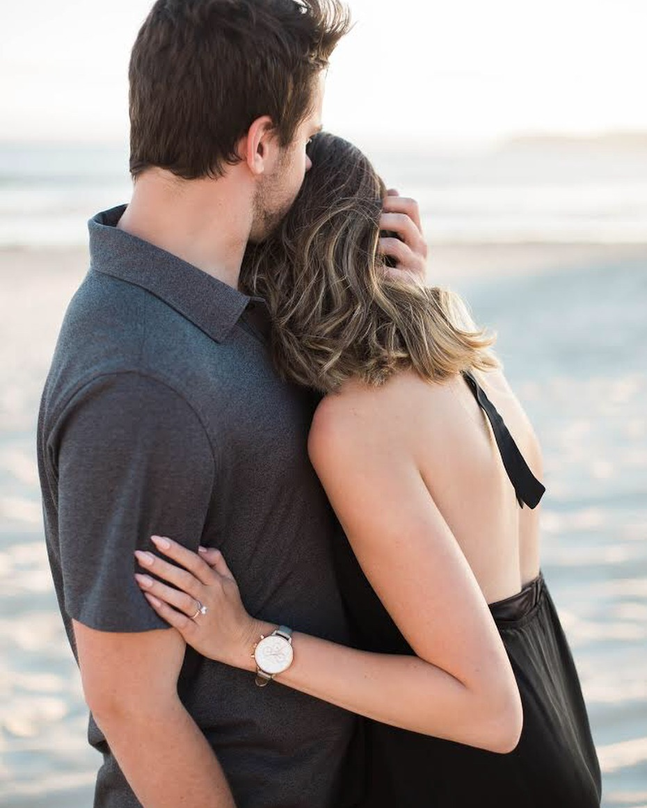 Couple just engaged on the beach; photo by Third Strand Photography