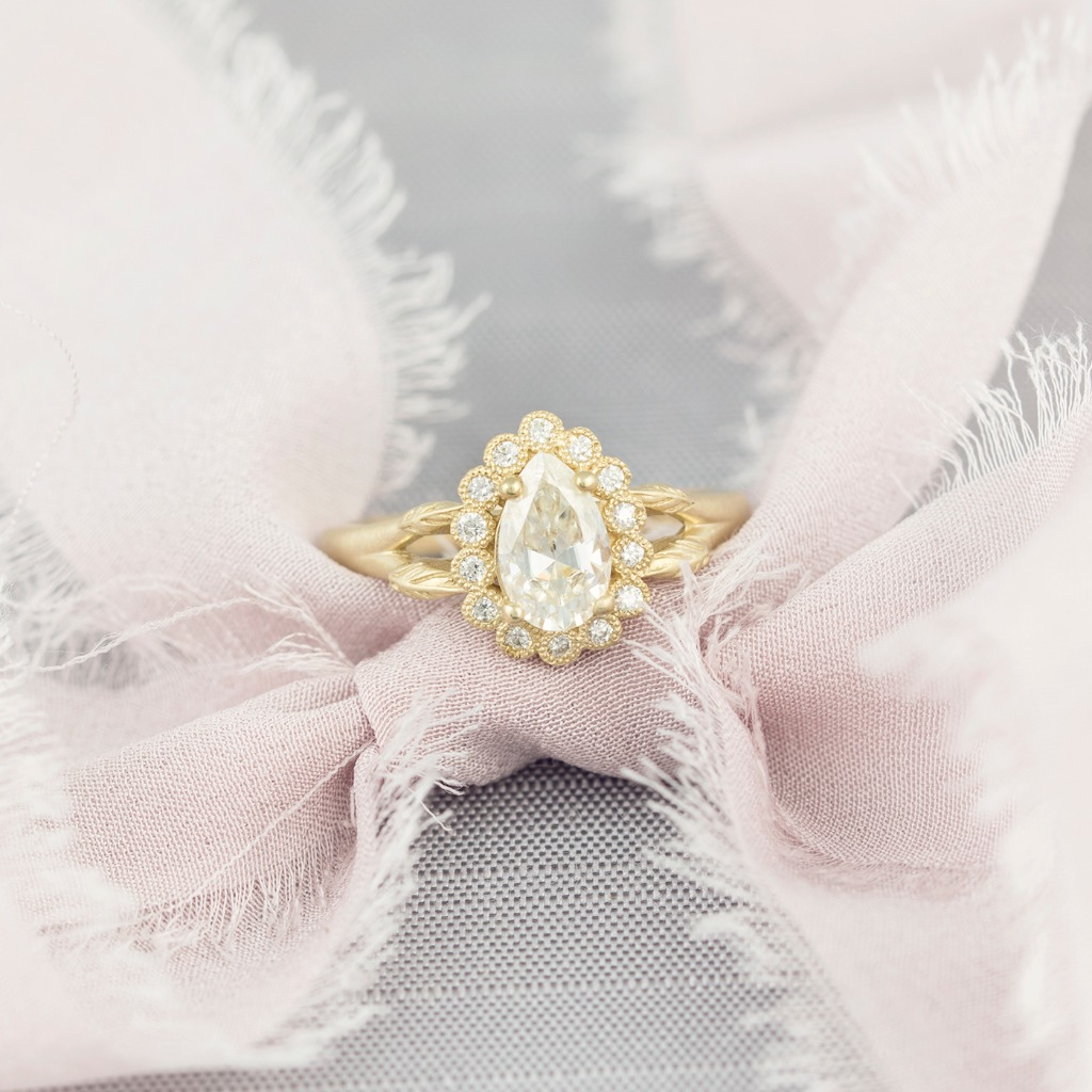 How bellisimo is this ring? Our Penelope ring is so delicate and romantic with its unique pear shaped diamond halo. The dreamiest.
