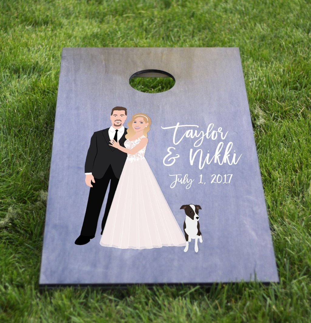 It's not too late to pick up one of these bad boys!! This Couple Portrait Cornhole Board from Miss Design Berry comes with all the