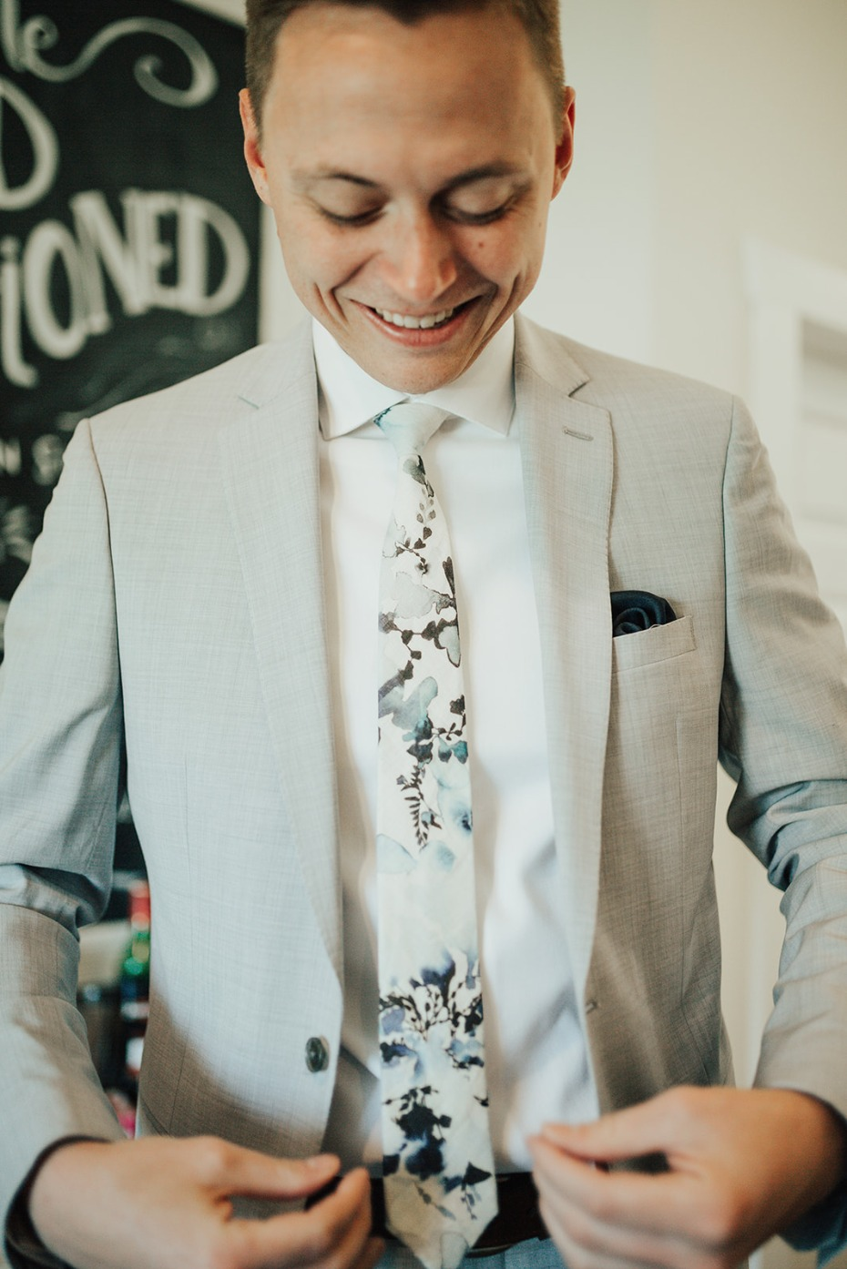 groom in grey and watercolor tie