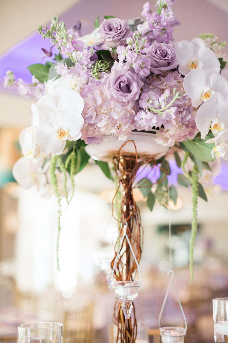 purple and white pedestal floral centerpieces