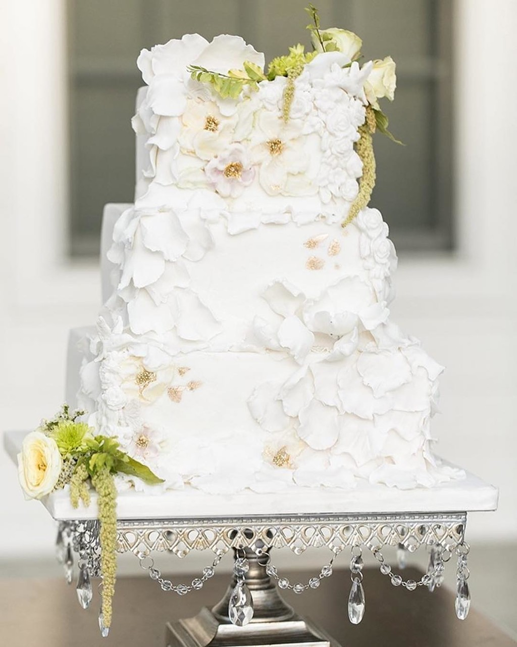 Pretty petal covered #weddingcake on our Antique Silver