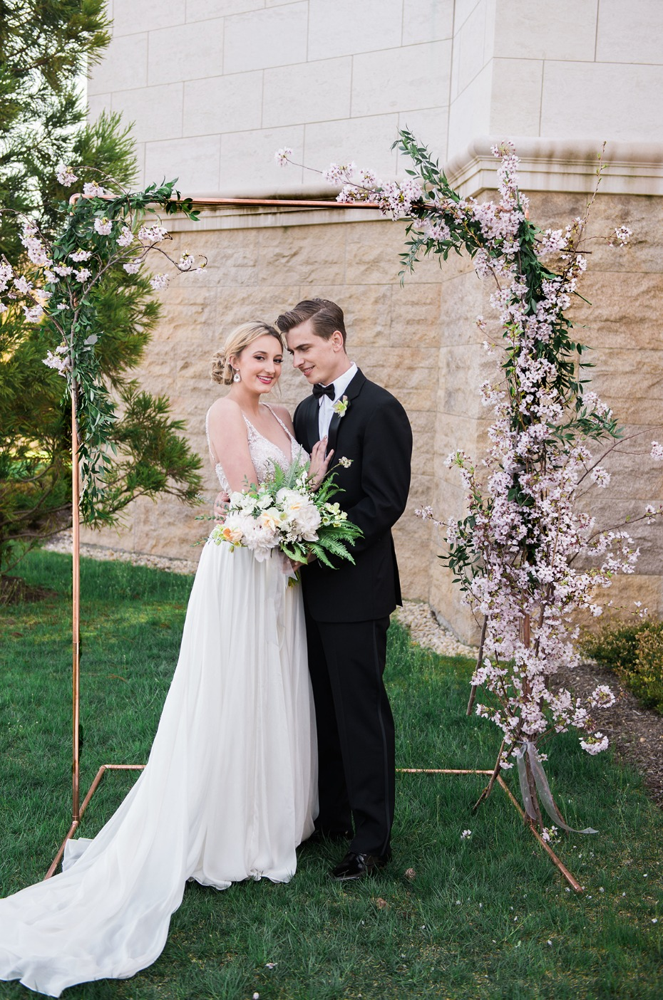 wedding couple and chic wedding backdrop