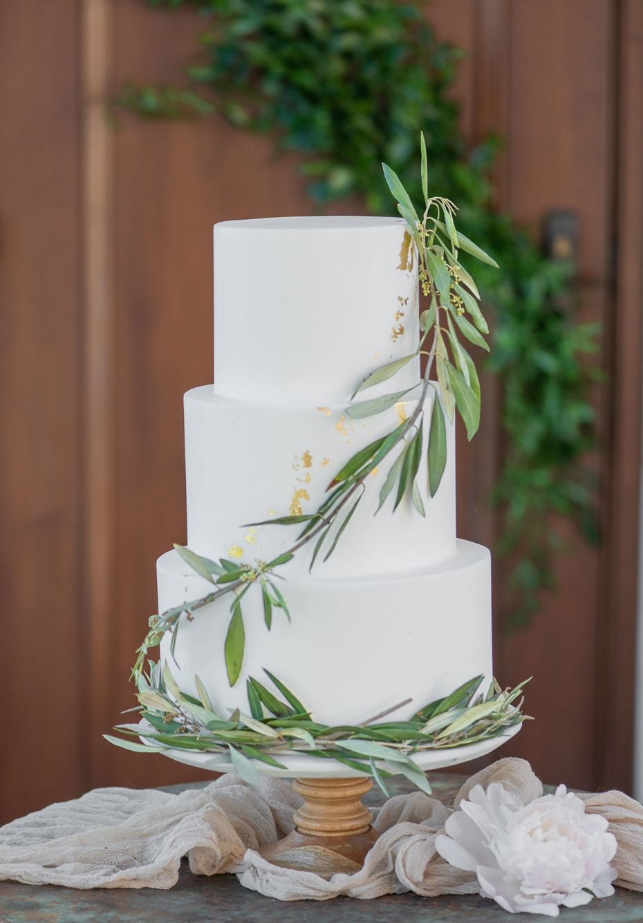 simple greenery accented wedding cake