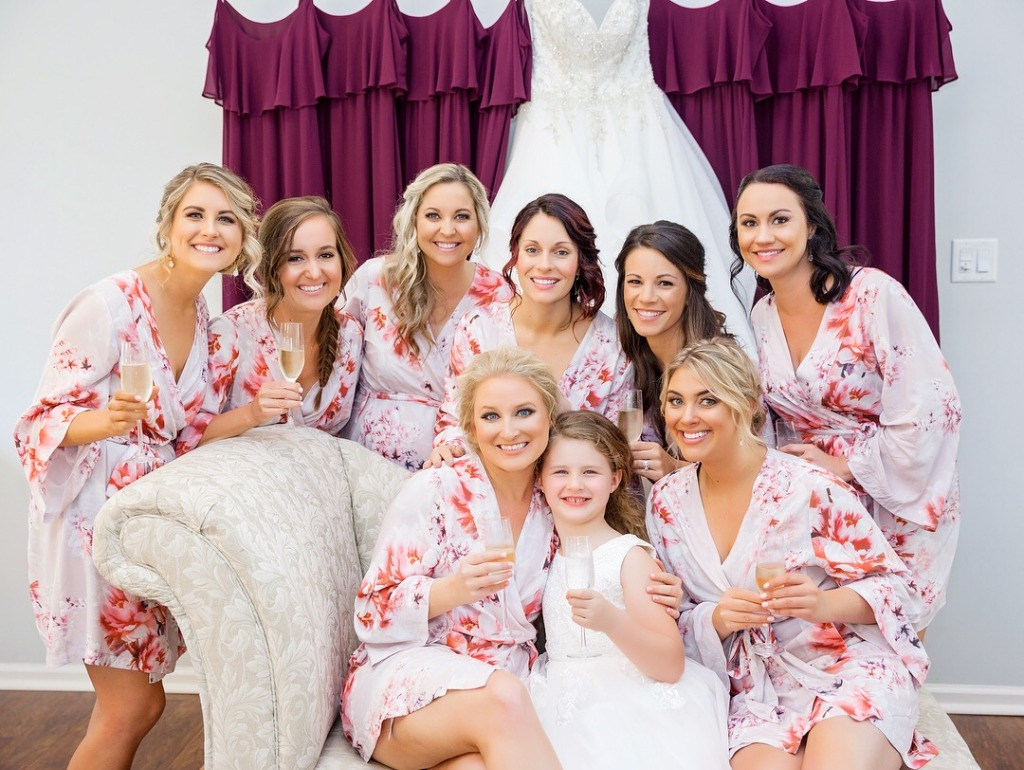 Blushing bridesmaids in pink robes. Perfect gift for the squad!