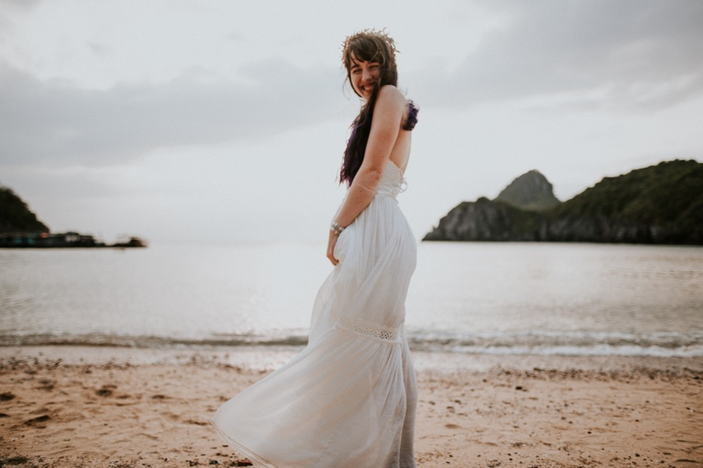 My dream is to get married by the beach, and this photo of you in your wedding dress smiling at me in Cat Ba, Vietnam is the best dream