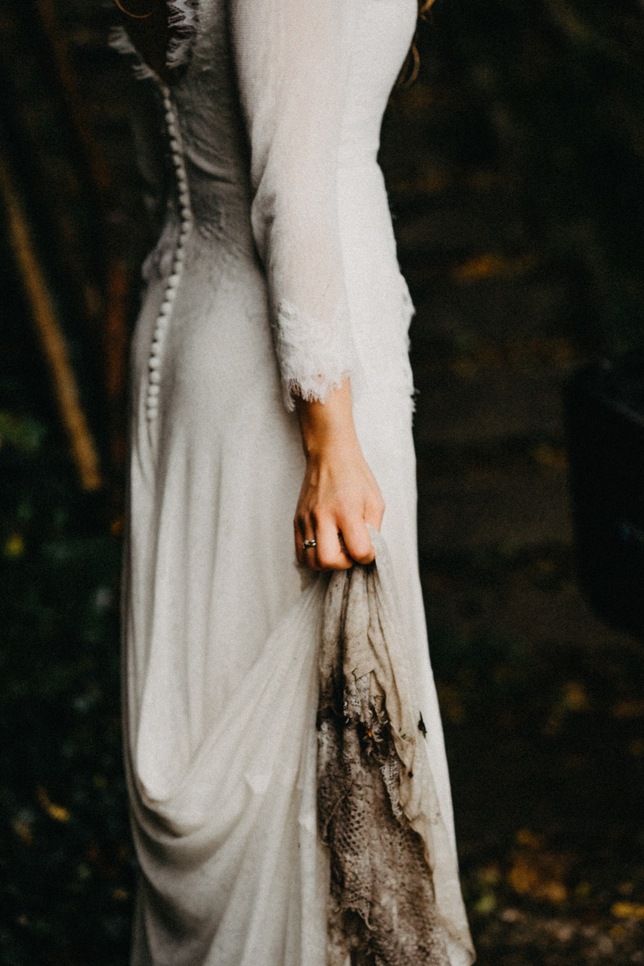 Creepy Bride Holding Her Black Stained Dress Up