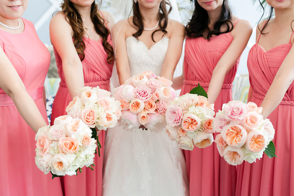 This bride tribe is perfectly color coordinated from their dresses to their bouquets, and we love it!