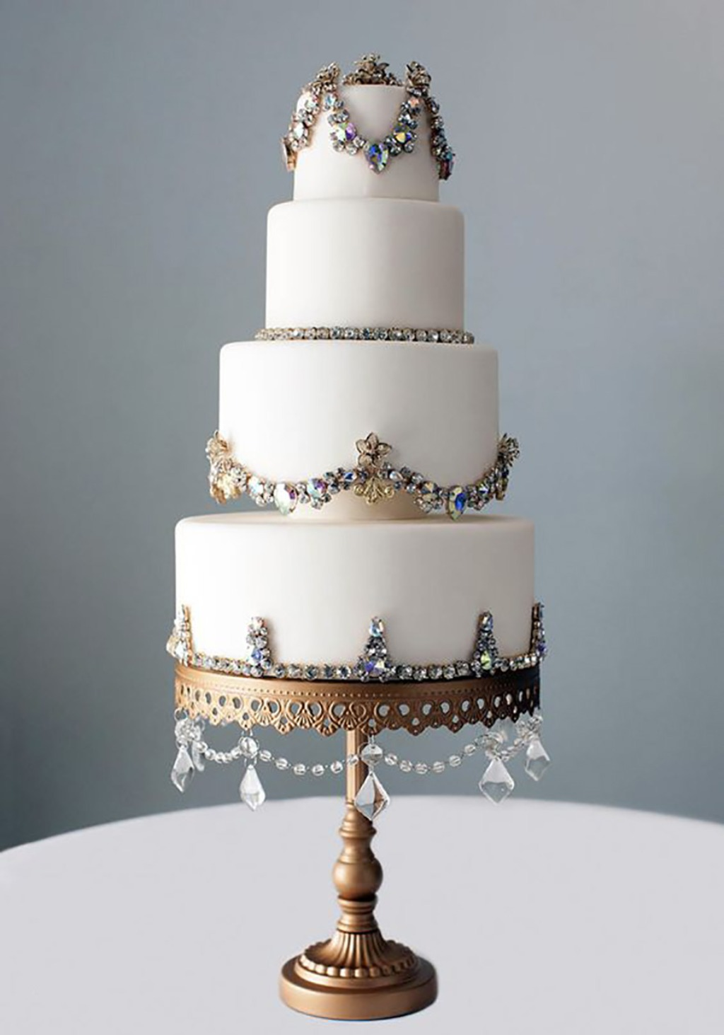 Beautifully Jeweled Tiered Wedding Cake on Chandelier Cake Stand