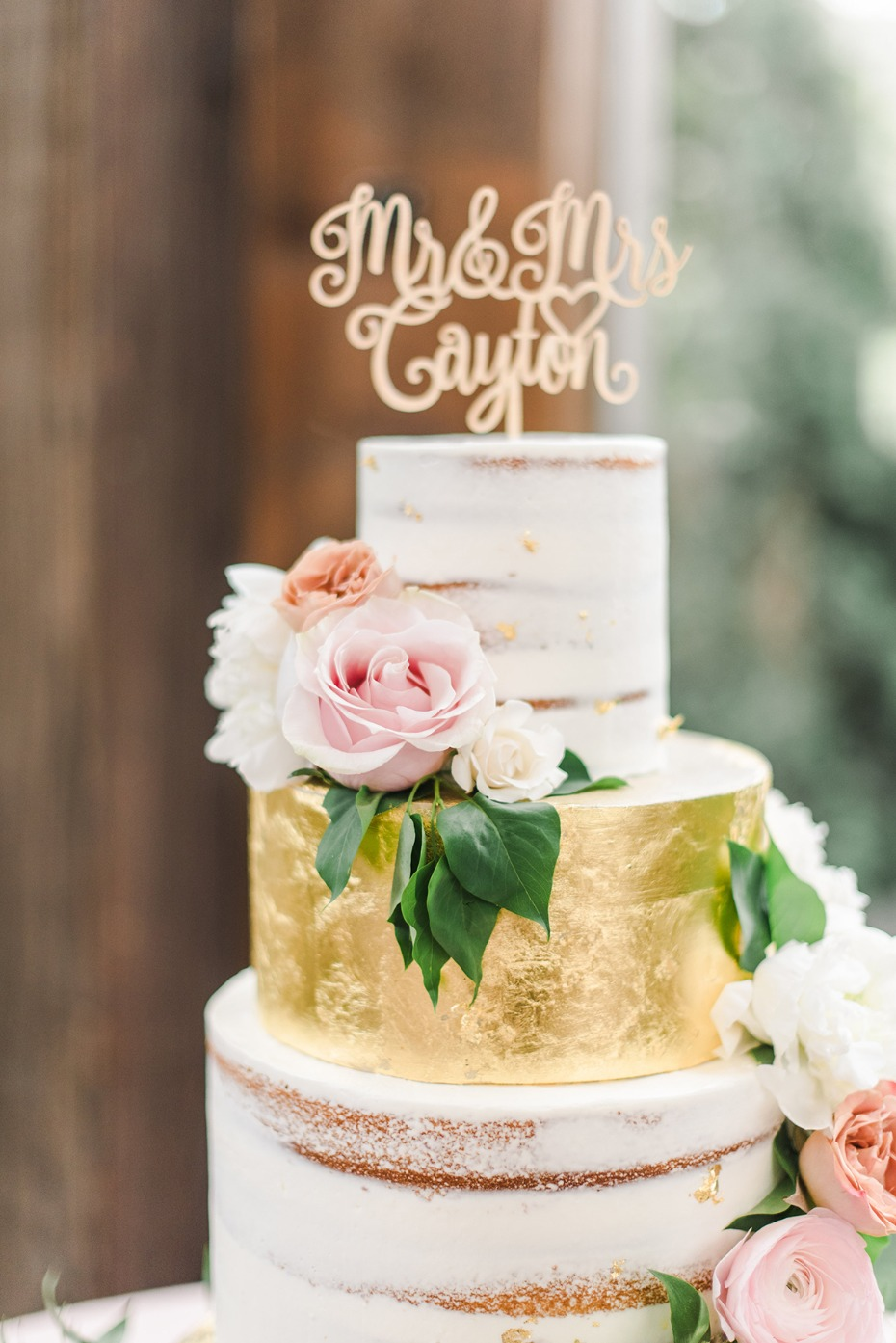 gold leaf nearly naked wedding cake