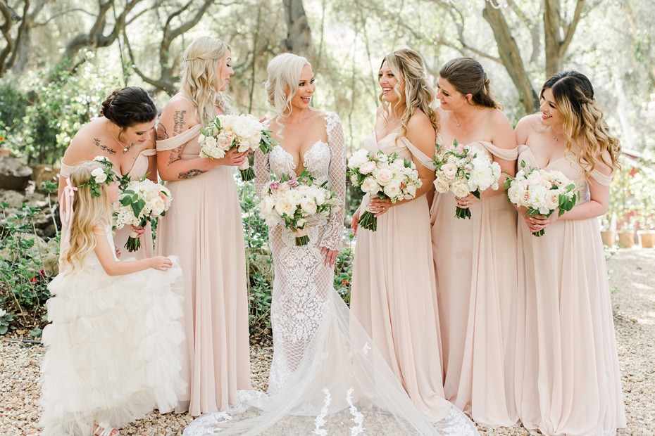 bride and her blush dressed bridesmaids