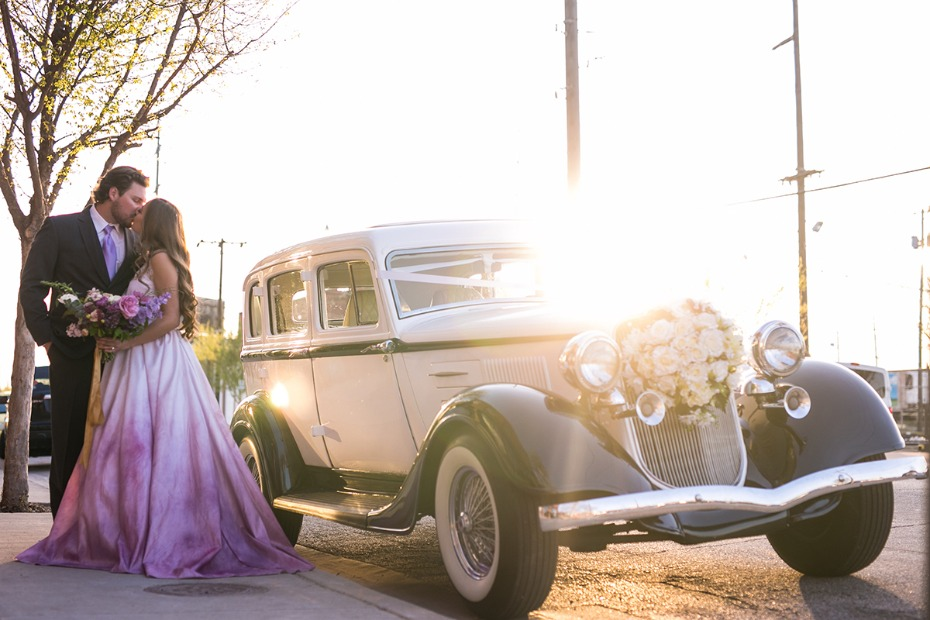 sunset wedding kiss and vintage transportation