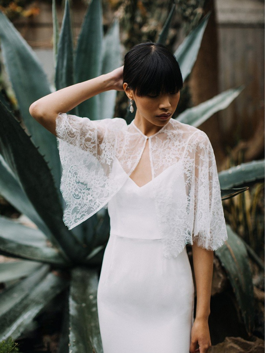 A modern take on a classic—lacy, feminine cover ups that add visual detail without compromising the view of your beautiful gown.