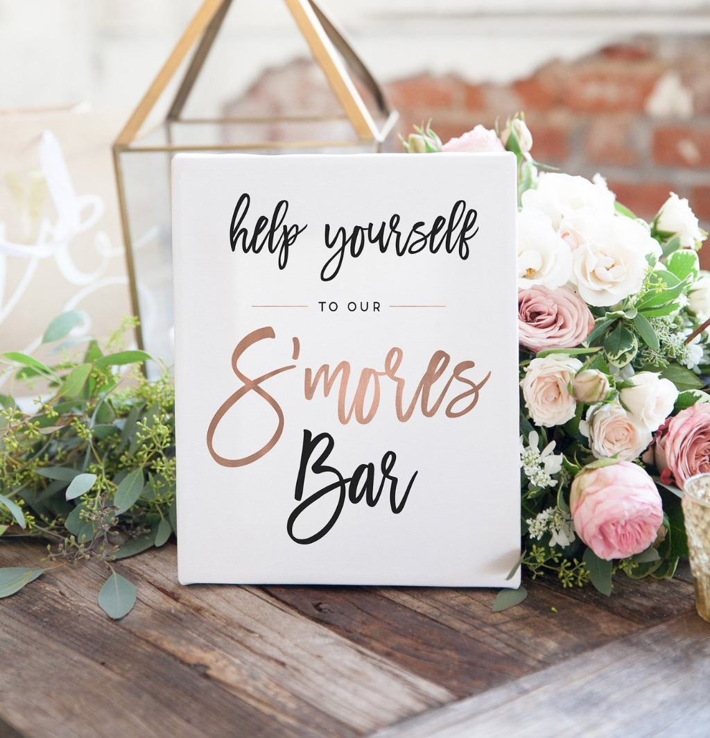 We LOVE a good sweets bar, so why not get a sign to let your guests know what's up?? This Wedding S'mores Bar Sign is perfect if you