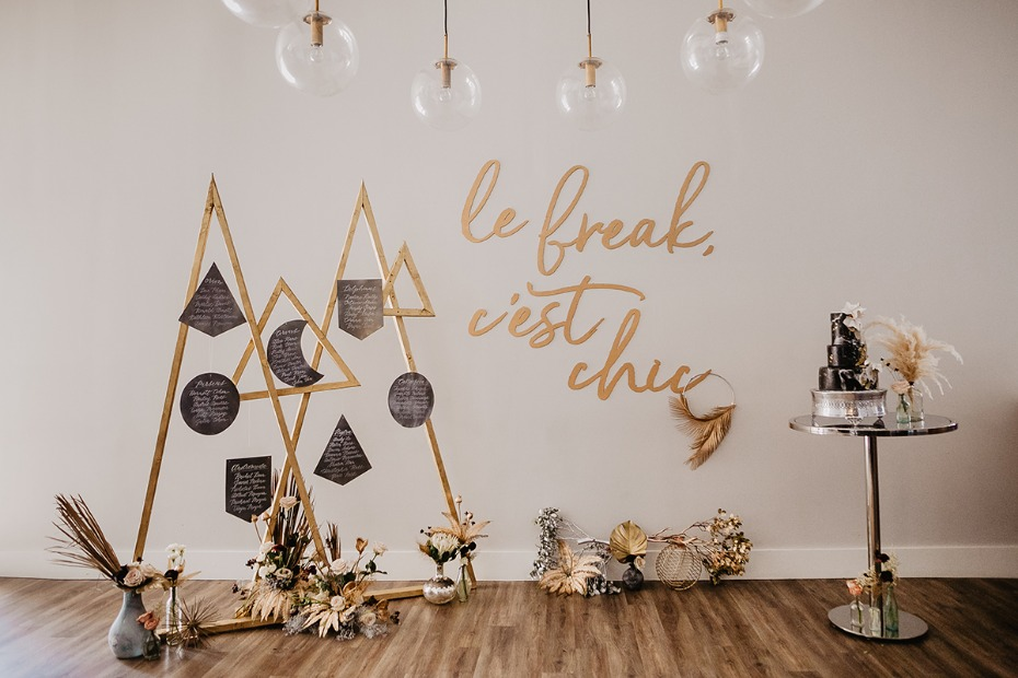 modern geometric seating assignment and cake table
