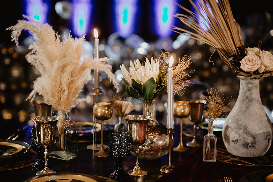 art deco inspired gold and white and midnight blue table