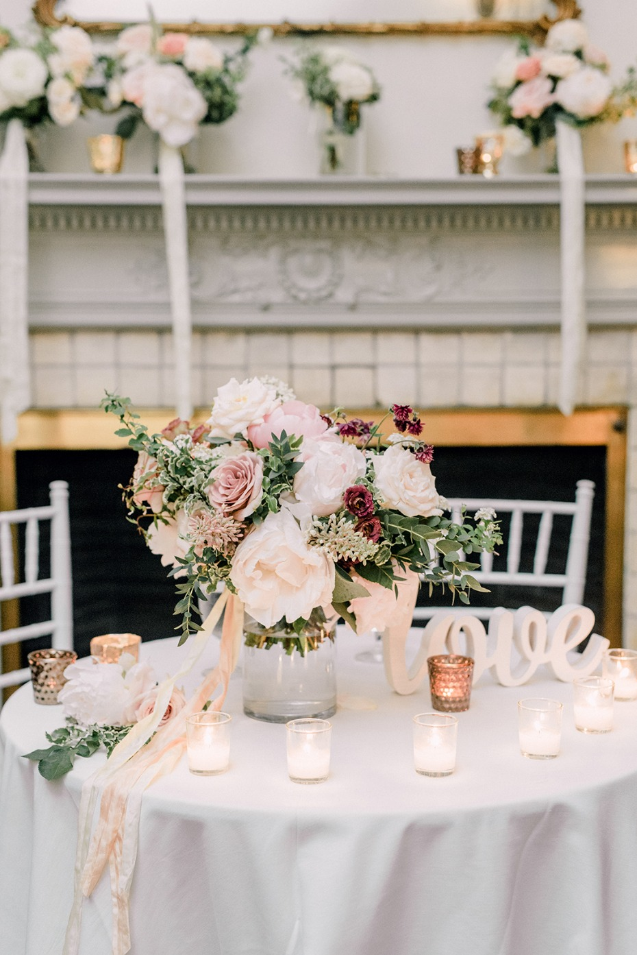 soft candle lit sweetheart table