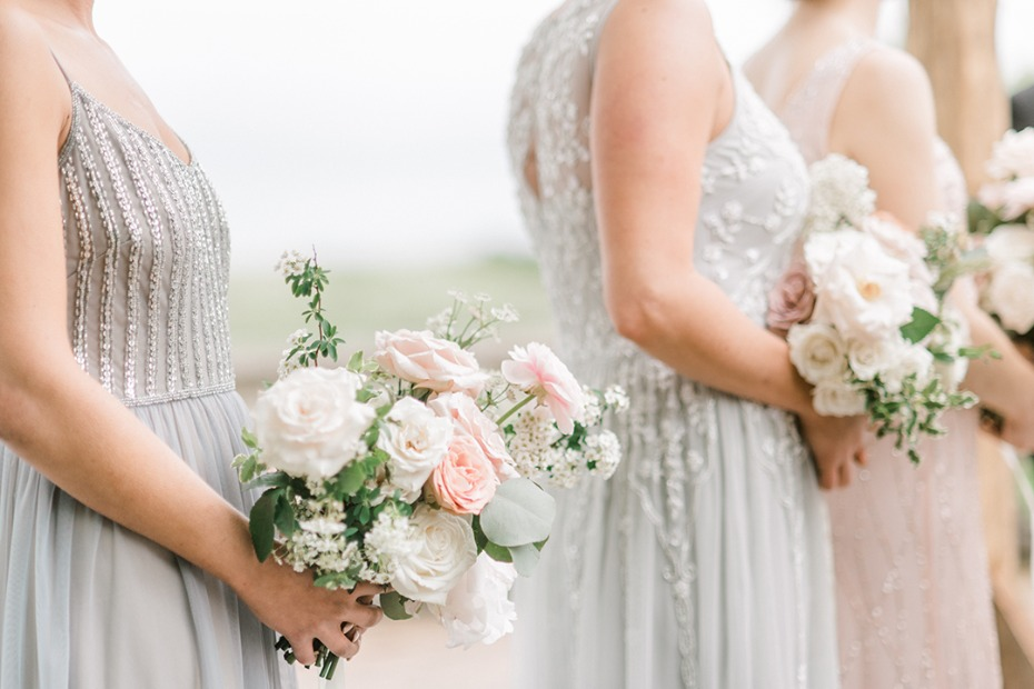 bridesmaids in soft grey with blush and white bouquets