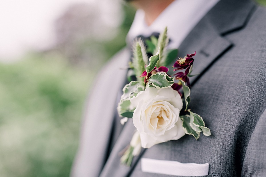 romantic white and burgundy boutonniere